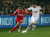 SWANSEA, WALES - MARCH 16: Raheem Sterling of Liverpool (L) is challenged by Jack Cork of Swansea during the Premier League match between Swansea City and Liverpool at the Liberty Stadium on March 16, 2015 in Swansea, Wales