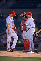 Syracuse Chiefs pitching coach Bob Milacki (48) talks with starting pitcher A.J. Cole (11) and catcher Pedro Severino (4) during a game against the Rochester Red Wings on July 1, 2016 at Frontier Field in Rochester, New York.  Rochester defeated Syracuse 5-3.  (Mike Janes/Four Seam Images)