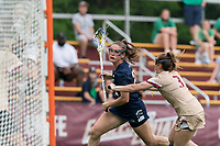 NEWTON, MA - MAY 22: Hannah Dorney #22 of Notre Dame on the attack as Annie Walsh #3 of Boston College defends during NCAA Division I Women's Lacrosse Tournament quarterfinal round game between Notre Dame and Boston College at Newton Campus Lacrosse Field on May 22, 2021 in Newton, Massachusetts.