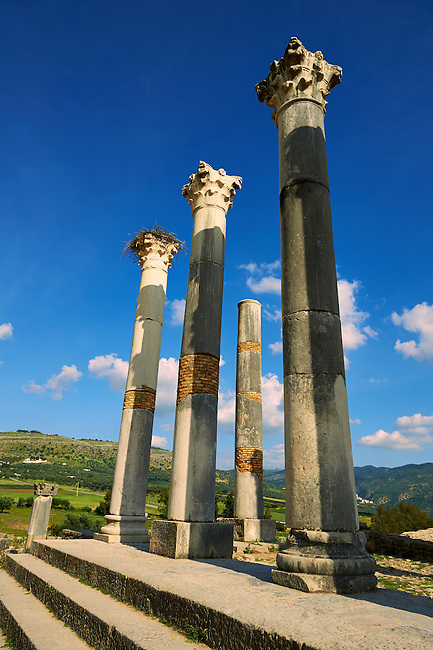 The Corintian columns of Capitoline Temple dedicated to the three chief divinities of the Roman state, Jupiter, Juno and Minerva.  Volubilis Archaeological Site, near Meknes, Morocco