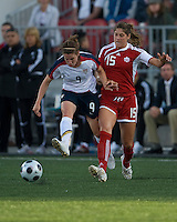 Heather O'Reilly, Kara Lang. The US Women's National Team defeated the Canadian Women's National Team, 4-0, at BMO Field in Toronto during an international friendly soccer match on May 25, 2009.