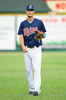 Rory Rhodes #33 of the Elizabethton Twins warms up in the outfield prior to the game against the Bluefield Blue Jays at Joe O'Brien Field on July 14, 2012 in Elizabethton, Tennessee.  The Twins defeated the Blue Jays 4-0.  (Brian Westerholt/Four Seam Images)