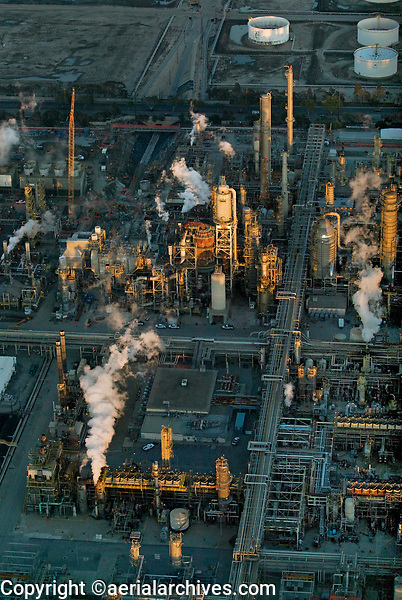 aerial photograph of Torrance Refining Company, Torrance, Los Angeles County, California at sunset