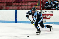 BOSTON, MA - JANUARY 04: Celine Tedenby #20 of University of Maine passes the puck during a game between University of Maine and Boston University at Walter Brown Arena on January 04, 2020 in Boston, Massachusetts.