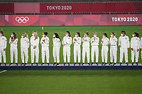 YOKOHAMA, JAPAN - AUGUST 6: The USWNT line up to receive their medals during the 2020 Tokyo Olympics Women's Soccer medal ceremony at International Stadium Yokohama on August 6, 2021 in Yokohama, Japan.