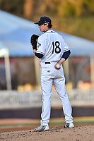Asheville Tourists starting pitcher Garrett Schilling (18) looks in for the signals during a game against the Columbia Fireflies at McCormick Field on April 13, 2018 in Asheville, North Carolina. The Tourists defeated the Fireflies 5-1. (Tony Farlow/Four Seam Images)