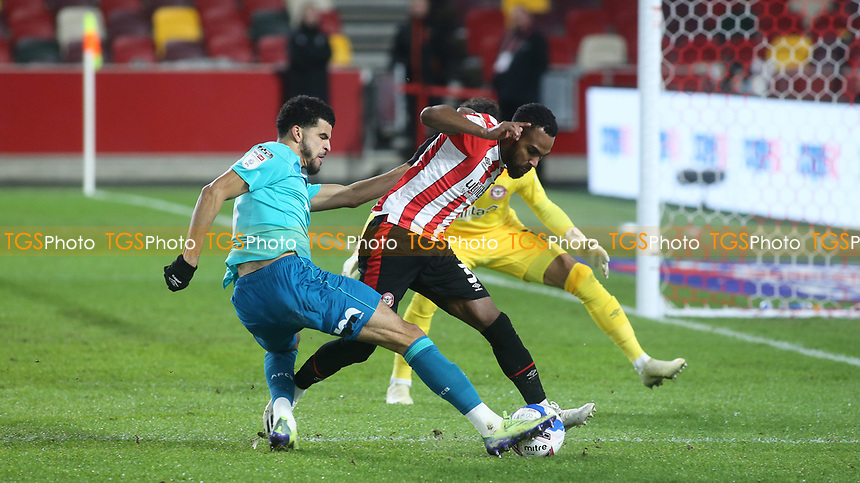 Rico Henry of Brentford tackles AFC Bournemouth's Dominic Solanke during Brentford vs AFC Bournemouth, Sky Bet EFL Championship Football at the Brentford Community Stadium on 30th December 2020