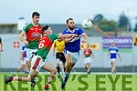 Sean Sheehan Templenoe gets to the ball ahead of Seanie O'Leary Kilcummin during the relegation play off final in Fitzgerald Stadium on Sunday