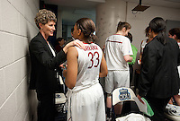 NORFOLK, VA--Coach Amy Tucker congratulates Amber Orrange after a win against Hampton University at the Ted Constant Convocation Center at Old Dominion University in Norfolk, VA in the first round of the 2012 NCAA Championships. The Cardinal advance with a 73-51 win to play West Virginia on Monday, March 19.