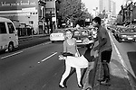"""Distressed young couple in the middle of the road, """"Before your found out"""" Sydney Australia."""