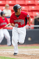 Edwin Garcia #13 of the Hickory Crawdads hustles down the first base line against the Kannapolis Intimidators at  L.P. Frans Stadium August 1, 2010, in Hickory, North Carolina.  Photo by Brian Westerholt / Four Seam Images
