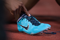 OLIVER David (USA) taking off his shoes after winning the 110m hurdles run at the IAAF Diamond League meeting in Stockholm.