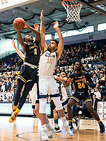 WASHINGTON, DC - FEBRUARY 22: Arnaldo Toro #11 of George Washington goes up with David Betty #1 of La Salle under the basket during a game between La Salle and George Washington at Charles E Smith Center on February 22, 2020 in Washington, DC.