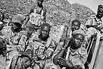 Sudan People's Liberation Army (SPLA) fighters are seen at an undisclosed location in South Kordofan, 5 July 2011. On the 5 June, after almost 10 years of relative peace, Sudan's President Omar Al-Bashir sent his army, the Sudan Armed Forces (SAF), to attack on the people of the Nuba Mountains in South Kordofan, using MiG fighters to shoot at vehicles, and Antonov cargo planes, converted to use as heavy bombers. (John D McHugh)