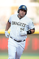 Matt Tuiasosopo (18) of the Charlotte Knights rounds the bases after hitting a home run against the Norfolk Tides at BB&T BallPark on July 17, 2015 in Charlotte, North Carolina.  The Knights defeated the Tides 5-4.  (Brian Westerholt/Four Seam Images)