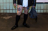 NEW YORK - NEW YORK. JANUARY 12: A participant of the No Pants Subway Ride takes a ride on the NYC subway system on January 12, 2020 in New York. The annual event, in which participants board a subway car in January while not wearing any pants while behaving as though they do not know each other, began as a joke by the public prank group Improv Everywhere in New York City and has since spread around the world, with enthusiasts in around 60 cities and 29 countries across the globe, according to the organization's site.  (Photo by Pablo Molsalve/VIEWpress)