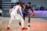 22nd February 2021, Podgorica, Montenegro; Eurobasket International Basketball qualification for the 2022 European Championships, England versus France;  Tarik Phillip of Great Britain takes on Thomas Heurtel (FRA)