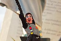 """Europe, Italy, Tuscany, Viareggio, a mime performs on the cart """"Aspettando Godot""""of Alessandro Avanzini"""