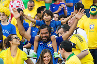 A brazilian fan with his son
