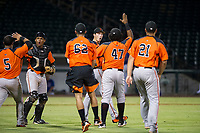 AZL Giants catcher Andres Angulo (1) and relief pitcher John Russell (53) are congratulated by Jeffry Parra (5), Deiyerbert Bolivar (62), Nathanael Javier (47), and Angeddy Almanzar (21) after a win against the AZL Cubs on September 6, 2017 at Sloan Park in Mesa, Arizona. AZL Giants defeated the AZL Cubs 6-5 to even up the Arizona League Championship Series at one game a piece. (Zachary Lucy/Four Seam Images)