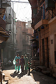 Jodhpur, India. Street scene with three women in saris and a boy.
