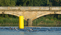 01 JUNE 2014 - LONDON, GBR - Competitors make the turn around a buoy by the Serpentine Bridge in Hyde Park in London, Great Britain during the Open Age Group Olympic Distance race of the 2014 ITU World Triathlon Series (PHOTO COPYRIGHT © 2014 NIGEL FARROW, ALL RIGHTS RESERVED)
