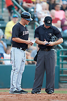 Kannapolis Intimidators manager Justin Jirschele (9) goes over a line-up change with home plate umpire Brandon Blome during the game against the Hickory Crawdads at L.P. Frans Stadium on July 20, 2018 in Hickory, North Carolina. The Crawdads defeated the Intimidators 4-1. (Brian Westerholt/Four Seam Images)