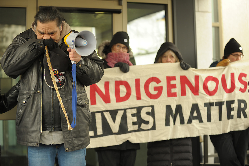 Walter Red Thunder, left, from Red Pheasant First Nation gets emotional during a rally in downtown Regina., Sask., Feb. 10, 2018 following the not guilty verdict in the Gerald Stanley trial. Stanley was charged in the shooting death of 22-year-old Colten Boushie of the Red Pheasant First Nation. THE CANADIAN PRESS/Mark Taylor