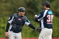 23 October 2010: Vincent Ferreira of Savigny talks to Tim Stewart during Savigny 8-7 win (in 12 innings) over Rouen, during game 3 of the French championship finals, in Rouen, France.