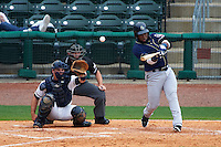 San Antonio Missions outfielder Yeison Asencio (14) at bat in front of catcher Micah Gibbs and umpire Lee Meyers during a game against the NW Arkansas Naturals on May 31, 2015 at Arvest Ballpark in Springdale, Arkansas.  NW Arkansas defeated San Antonio 3-1.  (Mike Janes/Four Seam Images)
