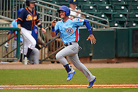 Tennessee Smokies outfielder Albert Almora (6) runs to first on a bunt base hit during a game against the Montgomery Biscuits on May 25, 2015 at Riverwalk Stadium in Montgomery, Alabama.  Tennessee defeated Montgomery 6-3 as the game was called after eight innings due to rain.  (Mike Janes/Four Seam Images)
