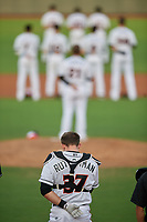 Delmarva Shorebirds catcher Adley Rutschman (37) during the national anthem before a South Atlantic League game against the Greensboro Grasshoppers on August 21, 2019 at Arthur W. Perdue Stadium in Salisbury, Maryland.  Delmarva defeated Greensboro 1-0.  (Mike Janes/Four Seam Images)