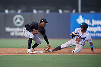 Jupiter Hammerheads shortstop Demetrius Sims (5) looks to tag Wilkerman Garcia (27) sliding in during a Florida State League game against the Tampa Tarpons on July 26, 2019 at George M. Steinbrenner Field in Tampa, Florida.  Tampa defeated Jupiter 2-0 in the first game of a doubleheader.  (Mike Janes/Four Seam Images)