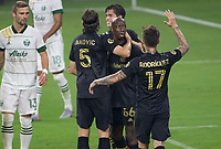 LOS ANGELES, CA - SEPTEMBER 13: Bradley Wright-Phillips #66 of the LAFC scores and celebrates with his LAFC team mates during a game between Portland Timbers and Los Angeles FC at Banc of California stadium on September 13, 2020 in Los Angeles, California.