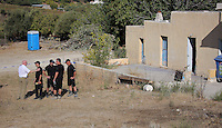 FAO JANET TOMLINSON, DAILY MAIL PICTURE DESK<br /> Pictured: Jon Cousins (L) of South Yorkshire Police speaks with colleagues next to the house where Ben Needham disappeared from, part of which (FAR LEFT) will be demolished as part of the search in Kos, Greece. Monday 03 October 2016<br /> Re: Police teams led by South Yorkshire Police, searching for missing toddler Ben Needham on the Greek island of Kos have moved to a new area in the field they are searching.<br /> Ben, from Sheffield, was 21 months old when he disappeared on 24 July 1991 during a family holiday.<br /> Digging has begun at a new site after a fresh line of inquiry suggested he could have been crushed by a digger.