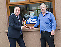First Minister Alex Salmond receives a bottle of whisky from  Landscape gardener Gordon Robertson whilst on the campaign trail.
