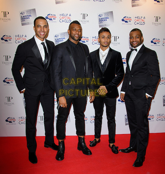 """LONDON, ENGLAND - NOVEMBER 28: JLS ( Marvin Humes, Oritse Williams, Aston Merrygold, Jonathan """"JB"""" Gill ) attend the annual 'Capital Rocks' concert in aid of the 'Help a Capital child' charity at The Roundhouse on November 28, 2013 in London, England. <br /> CAP/CJ<br /> ©Chris Joseph/Capital Pictures"""