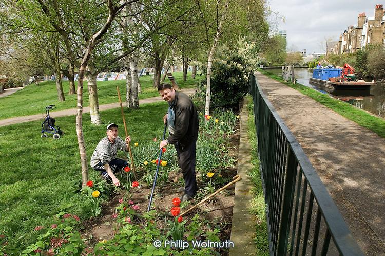 Gardener Joe Ambrosino and volunteer Eric Haynes working at Meanwhile Gardens, a community-run open space in North Kensington, London.
