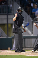 Home plate umpire Travis Godec makes a strike call during the International League game between the Buffalo Bison and the Charlotte Knights at BB&T BallPark on August 14, 2018 in Charlotte, North Carolina. The Bison defeated the Knights 14-5.  (Brian Westerholt/Four Seam Images)