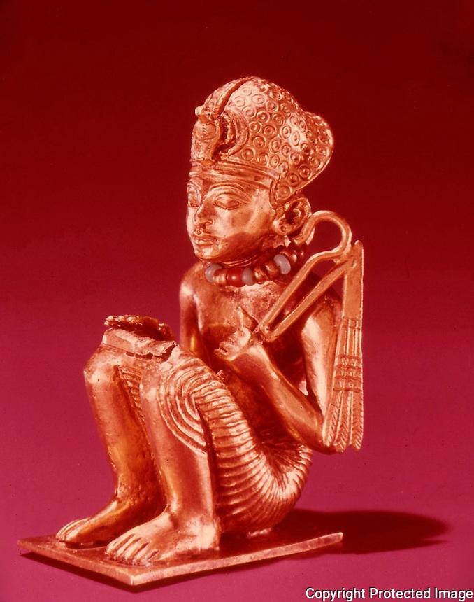 Egypt:  Squatting Figure of King--gold.  Treasures of Tutankhamun, Cairo Museum.  MMA 1976.