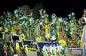 Rio de Janeiro, Brazil. Samba school float in green and yellow with lots of people; Carnival.