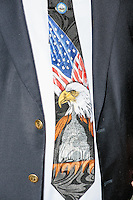 NH State Representative John A. Burt (R-Goffstown-Weare-Deering) wears a patriotic tie while Texas senator and Republican presidential candidate Ted Cruz greets people at The Village Trestle restaurant in Goffstown, New Hampshire, on Wed., Feb. 3, 2016. Burt said the tie is his lucky tie and that he wears it on the State House floor whenever he needs to get votes for legislation he's backing.
