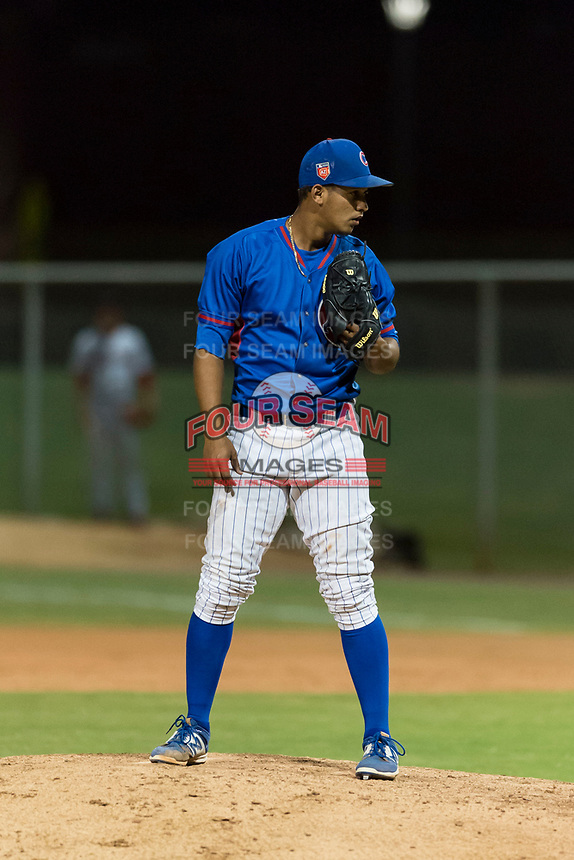AZL Cubs 2 relief pitcher Elias Herrera (67) looks in for the sign during an Arizona League game against the AZL Indians 2 at Sloan Park on August 2, 2018 in Mesa, Arizona. The AZL Indians 2 defeated the AZL Cubs 2 by a score of 9-8. (Zachary Lucy/Four Seam Images)