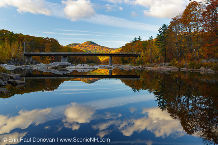 The Pemigewasset River in Woodstock, New Hampshire from Staple Rock Park during the autumn months. The Route 175 bridge is in view.