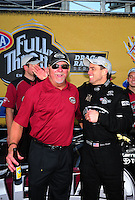 Oct. 16, 2011; Chandler, AZ, USA; NHRA top fuel dragster driver Larry Dixon (right) celebrates with team owner Alan Johnson after winning the Arizona Nationals at Firebird International Raceway. Mandatory Credit: Mark J. Rebilas-