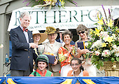 Julie Theriot, center in colored blouse, celebrates her Fantatic Foe's victory in an allowance race on the Virginia Gold Cup card.