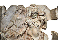 Close up of a RomanSebasteion relief  sculpture of Aineas' flight from Troy, Aphrodisias Museum, Aphrodisias, Turkey.   Against a white background.<br /> <br /> Aineas in armour carries his aged farther Anchises on his shoulders and leads his young son Lulus by his hand. They are fleeing from the sack of Troy. The figure floating behind is Aphrodite, Aineas' mother: she is helping their escape. Old Anchises carries a round box that held images of Troy's ancestral gods.