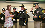 Tessa Richards watches as her father Sgt. Bill Richards takes the oath of office from Sheriff Kenny Furlong during a ceremony at the Carson City Sheriff's Office in Carson City, Nev., on Wednesday, April 24, 2013. .Photo by Cathleen Allison
