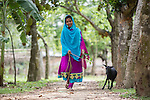 28 MAY, 2014, Gazipur District, Dhaka, Bangladesh.  Child marriage is an ongoing issue in Bangladesh where nearly two thirds of women are married before age 18.  Marriage before the age of 13 is common and two percent are married before age 11. <br /> <br /> Kazi Suliaman Kazi of Aktapara Dakil madrassa in Shimlapara Village<br /> <br /> Shahida Akther(19) who avoided being married off at a young age and wants to study zoology with her mother Sharifunnesa at their home in Shing Dhigi village.<br /> <br /> <br /> Picture by Graham Crouch/The Australian Magazine