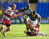 Anthony Watson of London Irish is tackled by Mike Tindall of Gloucester Rugby as James Simpson-Daniel of Gloucester Rugby looks to get involved during the Aviva Premiership match between London Irish and Gloucester Rugby at the Madejski Stadium on Saturday 8th September 2012 (Photo by Rob Munro)